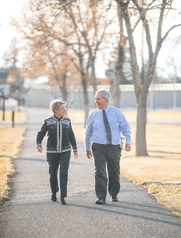 Caroline and RJ Kost walk at Homesteader Park last week. They wake up early to exercise. Last year, RJ Kost made a commitment to work out regularly and eat better. Since then, he has lost 110 pounds.