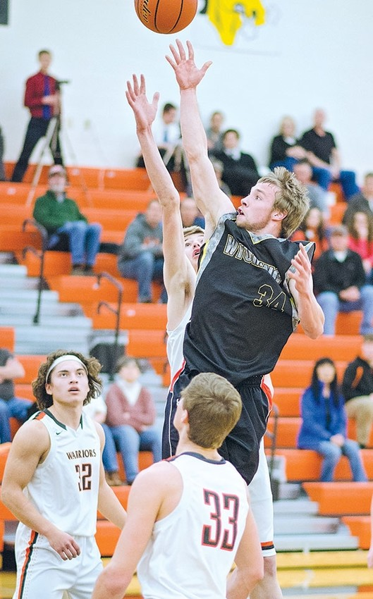 Panther senior T.J. Abraham goes up for a shot during a February 2016 game against Worland. The Panther basketball teams will kick off the season this Friday.