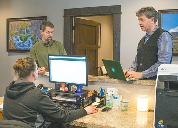 Drs. Bob Chandler (standing, left) and Mike Tracy coordinate with nurse Amanda Lowery at 307Health on Monday. 307Health and Hertiage Health Center both opened their doors a little over a year ago to provide additional medical care options for people in Powell and the Big Horn Basin.
