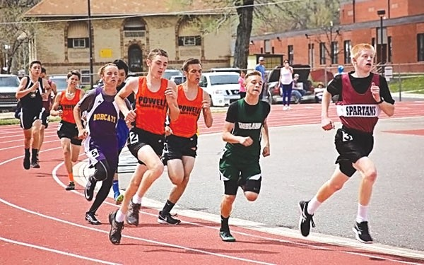 Cub runners Cole Frank and Jace Bohlman, front, compete for third place in the 800 meter run, while teammate Ethan Bartholomew makes up ground from the back at the Yellowstone Conference Track Meet in Thermopolis.