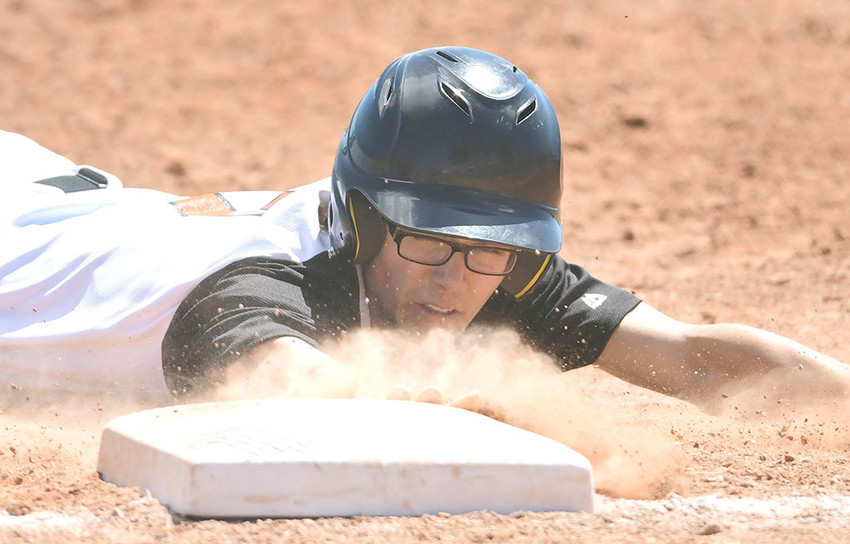 Pioneer baserunner Reece Hackenberg narrowly avoids the tag on a pickoff attempt Saturday at American Legion Field. The Pioneers dropped both games of a doubleheader to the Billings Blue Jays, 11-7 and 21-10.
