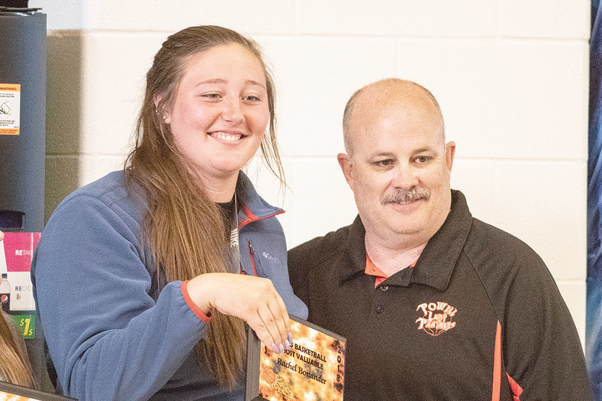 Lady Panther Rachel Bonander receives the 2017-18 Most Valuable Player plaque from girls' head basketball coach Scott McKenzie at last month's PHS Athletic Awards Night.