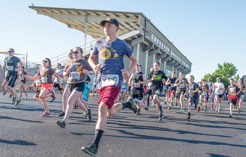 Caleb Schulz of Powell finds his stride at the start of the seventh annual Dano'lope' Dash on Saturday, June 2, at the Park County Fairgrounds. The event had it's biggest field yet with 136 participants. Schulz finished second in the 5K 11-19 male division with a time of 22:01.3.