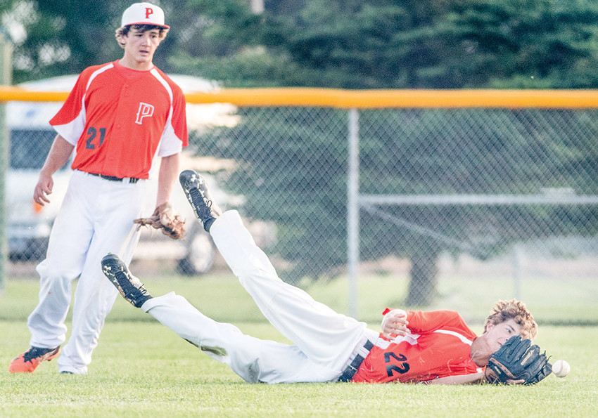A diving Cameron Wentz just misses coming up with a circus catch for the Powell Pioneers against the Casper Drillers Friday night at Ed Lynn Memorial Field. Casper came away with a 16-3 win.