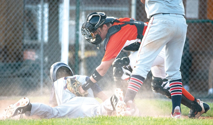 Powell Pioneers catcher Cameron Schmidt slaps a tag on Casper's Harrison Taubert in a game at Ed Lynn Memorial Field earlier this season. The Pioneers picked up one win at the Harold Gjerde Memorial Tournament in Lewistown, Montana, over the weekend.