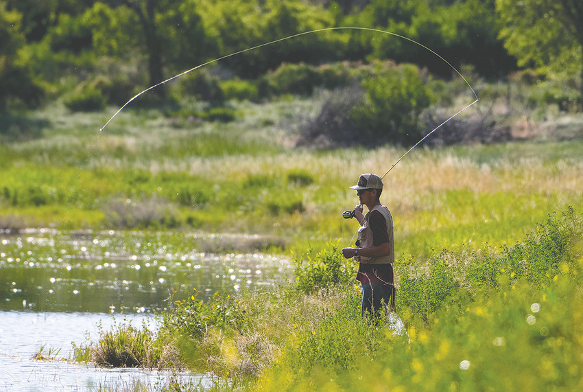 A fly fisherman tries his luck at West Newton Lake in Cody on a recent afternoon. Local and state leaders believe outdoor recreation can help diversify the economy.