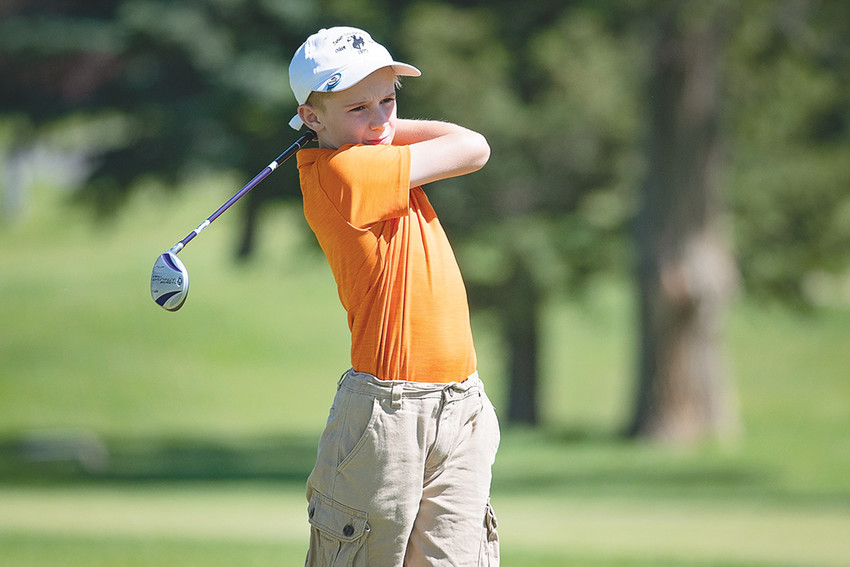 Ten-year-old Jacob Thomas tees off Wednesday morning on Hole 17 during the Members-Juniors Scramble at the Powell Golf Club. The event is part of the club's summer junior golf program.