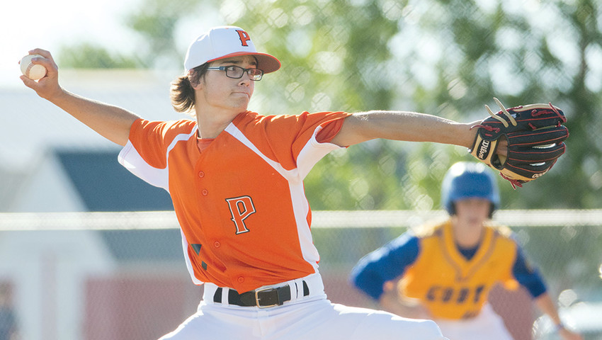 Pioneer pitcher Reece Hackenberg winds and delivers Tuesday against the Cody Cubs at Ed Lynn Memorial Field. The Pioneers dropped both games of a doubleheader against their cross-county rivals, 22-1 and 10-7.