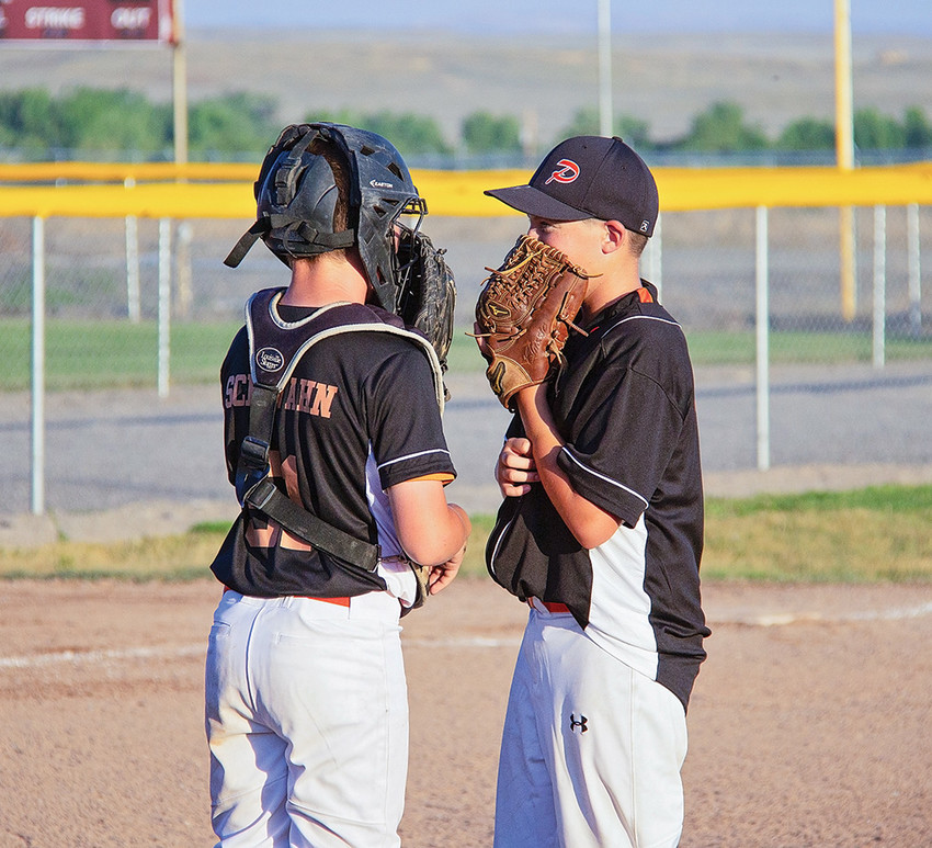 Powell catcher Jhett Schwahn confers with pitcher Cade Queen during a break in the action at the Battle at the Winds Tournament in Riverton. Powell went 4-0 in the tournament, bringing home the championship.