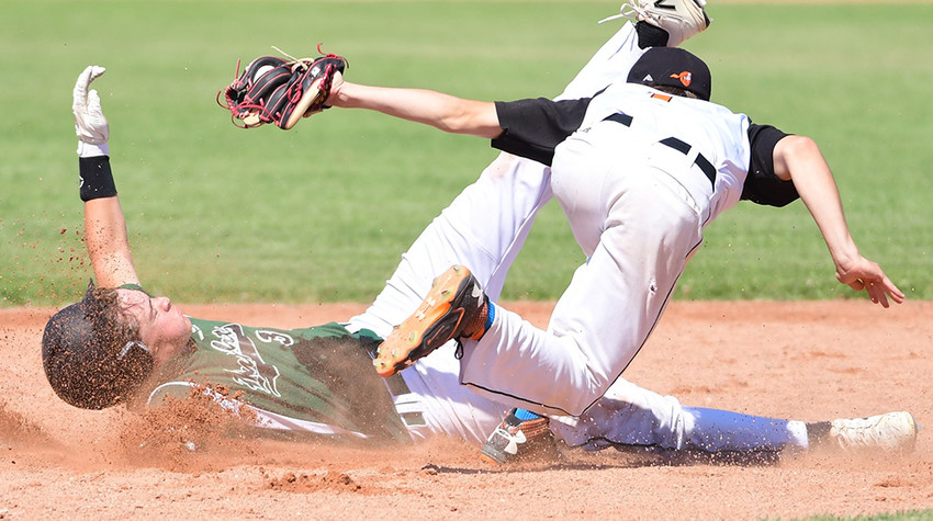 Pioneers second baseman Reece Hackenberg tags out a Green River baserunner on an attempted steal during the district tournament in Cowley on Thursday. Green River won the teams' fourth meeting, 5-3.