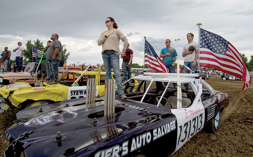 First-time derby driver Christeena Murdock, her husband Tait and son Carson pause for the national anthem prior to action at the 2018 Park County Fair demolition derby. Murdock won her heat in the limited weld class and finished in second place in the finals.