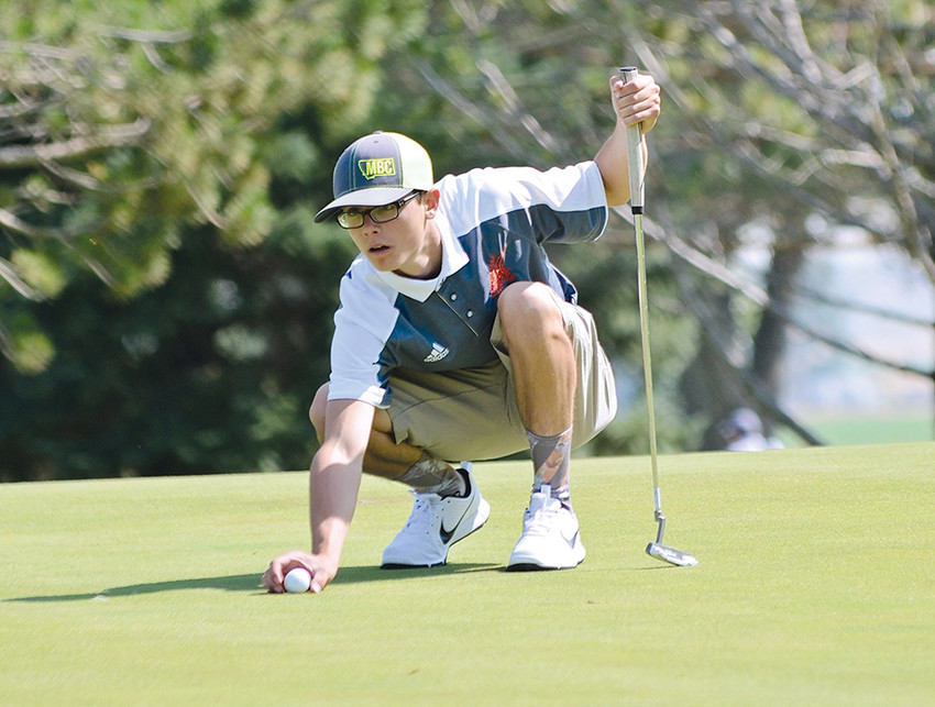 Panther golfer Reece Hackenberg lines up a putt during a tournament last season. The PHS golf teams open their 2018 campaign this week with the Cody/Powell Invitational.