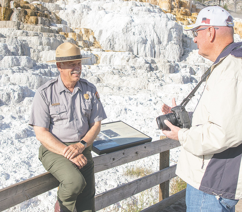 Yellowstone Superintendent Dan Wenk talks with a park visitor at Mammoth Hot Springs last month. Wenk is retiring from the National Park Service at the end of September.