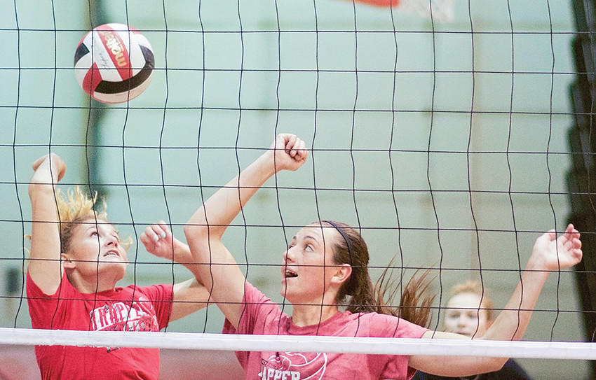 NWC volleyball players Lexi Brown (left) and Shania Warren defend the net during volleyball practice last week at Cabre Gym. The Lady Trappers have an even mix of freshman recruits and sophomore returners to start the 2018 season.