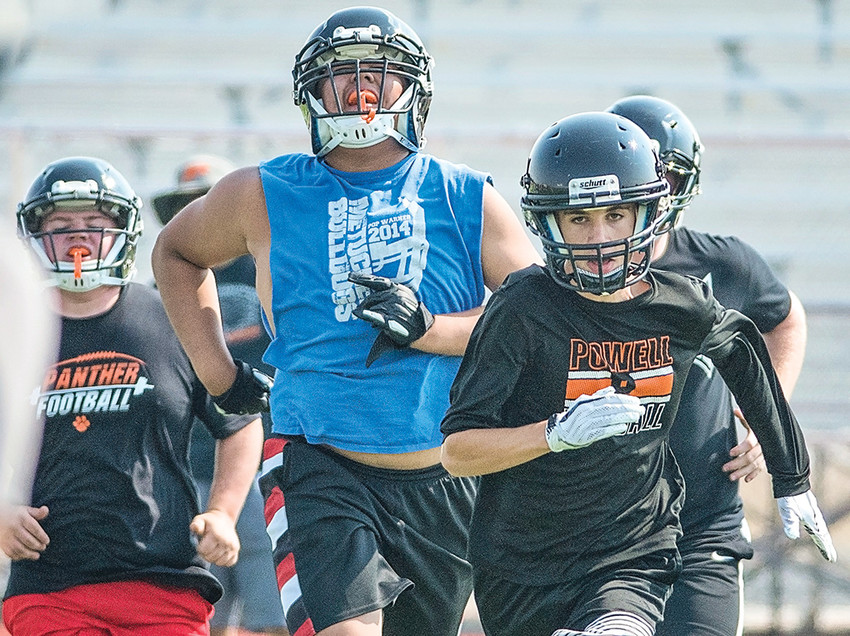 Panther football players (from left) Andy Beavers, Duy Hoang and Jack Pool run sprints during practice Tuesday at Panther Stadium. Practice began Monday for Class 3A schools across the state.