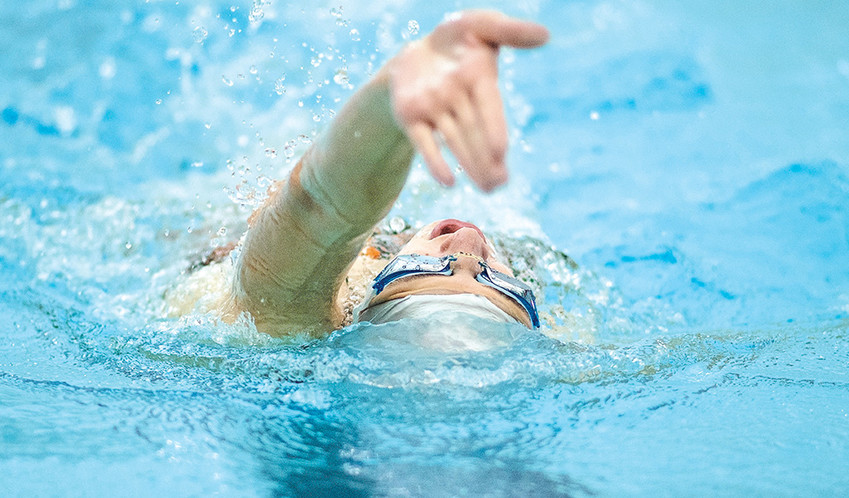 Lady Panther swimmer Addison Moretti works on her backstroke Tuesday during practice at the Powell Aquatic Center. The PHS girls' swimming and diving team opens the 2018 season Saturday at the Lander Invitational.