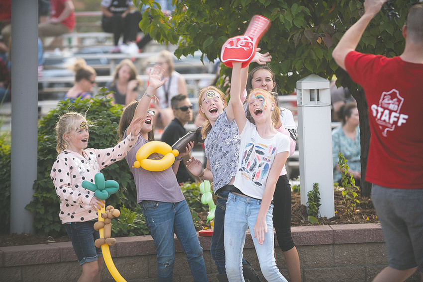 Ava Gilliat, Allie Gilliat, Emma Brence, Kathryn Brence and Bella Bertangole ham it up for the camera at Friday's Paint the Town Red event in downtown Powell.