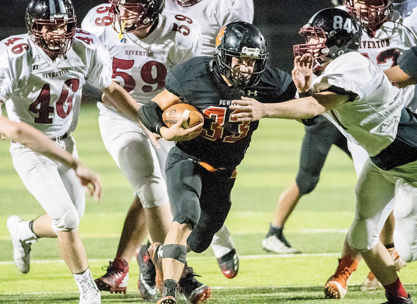 PHS Panther running back Brody Karhu bowls his way through Riverton's defense during Powell's 29-7 Zero Week win on Aug. 24. The Panthers open the regular season in Worland on Friday, facing the Warriors.