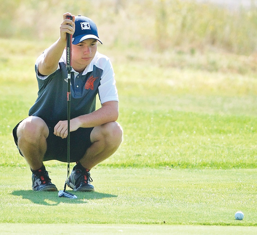 Panther golfer Crandell Sanders lines up a putt during a tournament at Powell Golf Club earlier this season. Sanders finished 10th at the 3A West Conference Tournament over the weekend, earning All Conference honors.