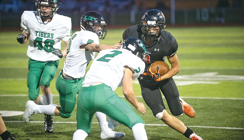 Powell receiver Dalton Woodward powers through Lander's Max Mazurie (2) and John Fawson (6) during the Panthers' home opener at Panther Stadium. Woodward caught a pair of second-half touchdown passes in the 28-26 Friday loss.