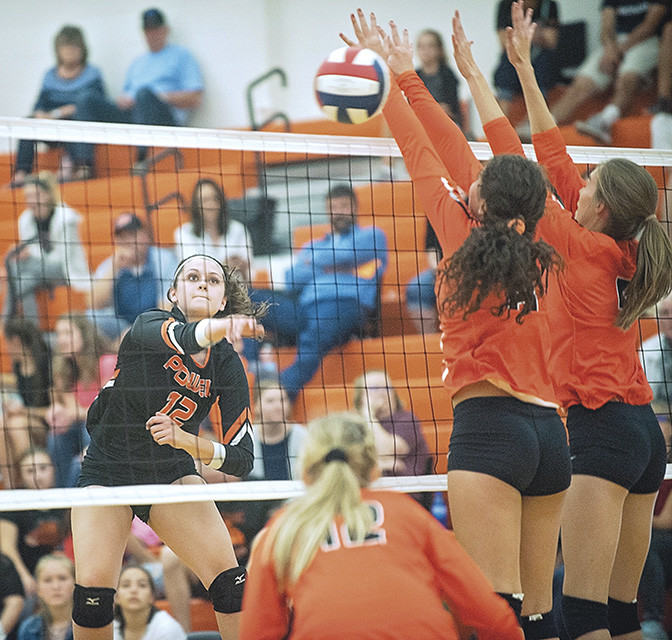 Powell's Hartly Thorington spikes the ball over a pair of Worland blockers Saturday at Powell High School Gym. The Lady Panthers swept the Lady Warriors 25-18, 25-16, 25-16 and sit atop the 3A Northwest conference.