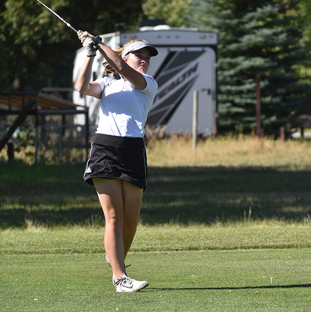 Lady Panther golfer Mycah Wainscott tracks her shot Saturday during the Class 3A State Golf Tournament in Riverton. Wainscott shot rounds of 97 and 101 to finish tied for ninth in the tournament, earning All-State honors.