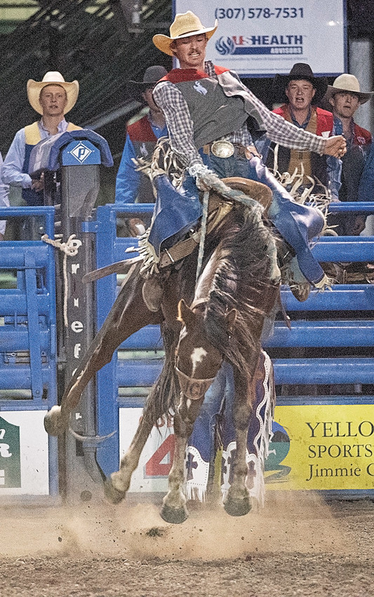 Trapper sophomore Caleb McMillan stays atop his horse to complete an 8-second ride in the saddle bronc competition during the Trapper Stampede Rodeo on Saturday, Sept. 8 in Cody. McMillan is off to a great start this season, winning all-around cowboy in two of three rodeos.