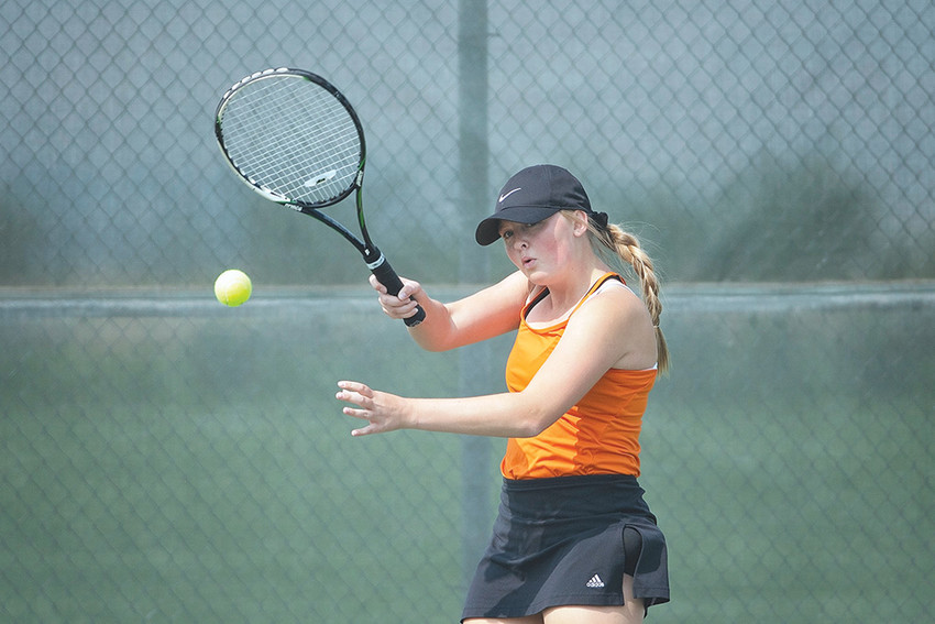 Lady Panthers No. 2 singles player Sierra Sanders returns a serve during a recent match against Jackson. Sanders finished fourth in last weekend's state tournament.