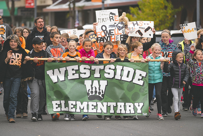 Westside Elementary School students proudly carry their school's banner down Bent Street during the Homecoming Parade on Friday afternoon. On Monday, the U.S. Department of Education named Westside a 2018 National Blue Ribbon School — one of only three in Wyoming. The school will host a celebration next week.