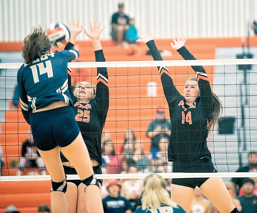 Lady Panthers Rachel Bonander (left) and Devon Curtis go up for a block against Cody's Paige Powell on Tuesday, Sept. 25 at Powell High School. Powell lost to the Fillies in straight sets 25-15, 25-19, 25-20.