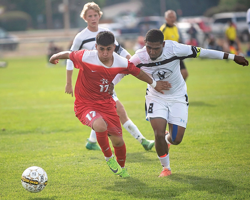 Trapper midfielder Jonathan Reynoso battles Gillette's Cheslon Carolisen for possession of the ball last week at Trapper Field. After losing to the Pronghorns at home, NWC won the rematch at Gillette 1-0 Saturday.