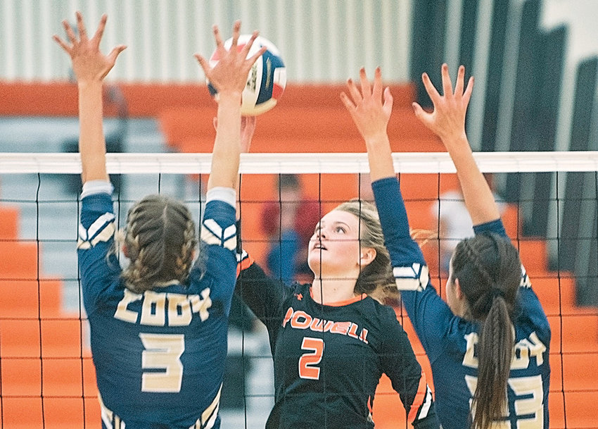 Powell's Aubrie Stenerson attempts to spike over Cody's Morgan Forconi and Brittan Bower during a recent game at Powell High School. The Lady Panthers finished 1-3 over the weekend at the 3A West Conference Duals in Lander.