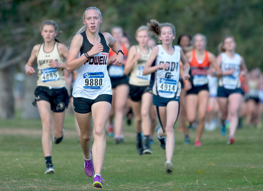 Lady Panther runner Kayla Kolpitcke leads a pack of runners Friday afternoon during the Powell Invitational at the Powell Golf Club. Kolpitcke finished sixth in the event with a time of 20:07.17.
