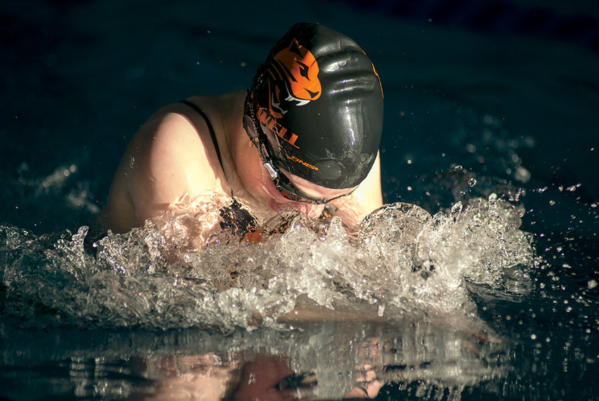 Powell's Colette Sanders competes in the 100 breaststroke during a three-team meet at the Powell Aquatic Center on Friday.