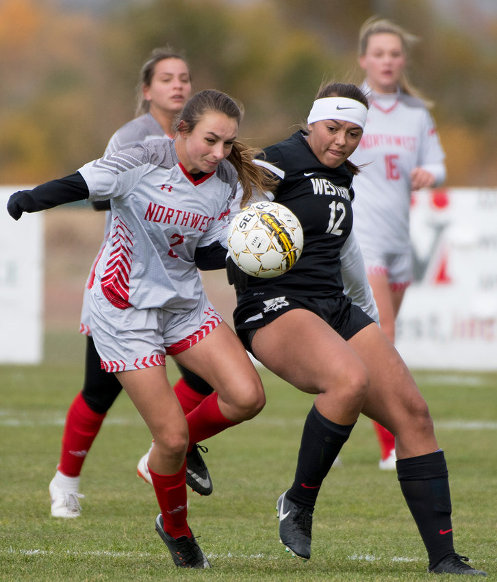 NWC's Jules Novakovich, of Cody, battles Western Wyoming's Emma Barnes for the ball last week in the Lady Trappers' season finale at Trapper Field.