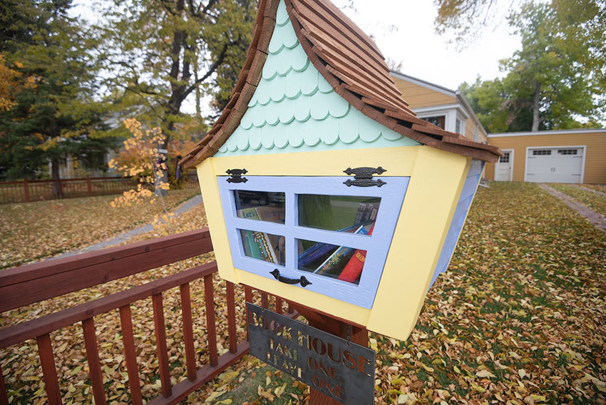 A whimsical book house on North Douglas Street encourages readers of all ages to take a book or leave one. Luke Robertson built the free little library as a gift for his wife, Anna Hardy. 'I've reached a point in my life where I don't really need more stuff, so I requested food and house projects (built-in shelves, a shelf over the bathroom door, book house, etc.) hoping that my crafty dad, brother or husband would make me something neat,' Hardy said.