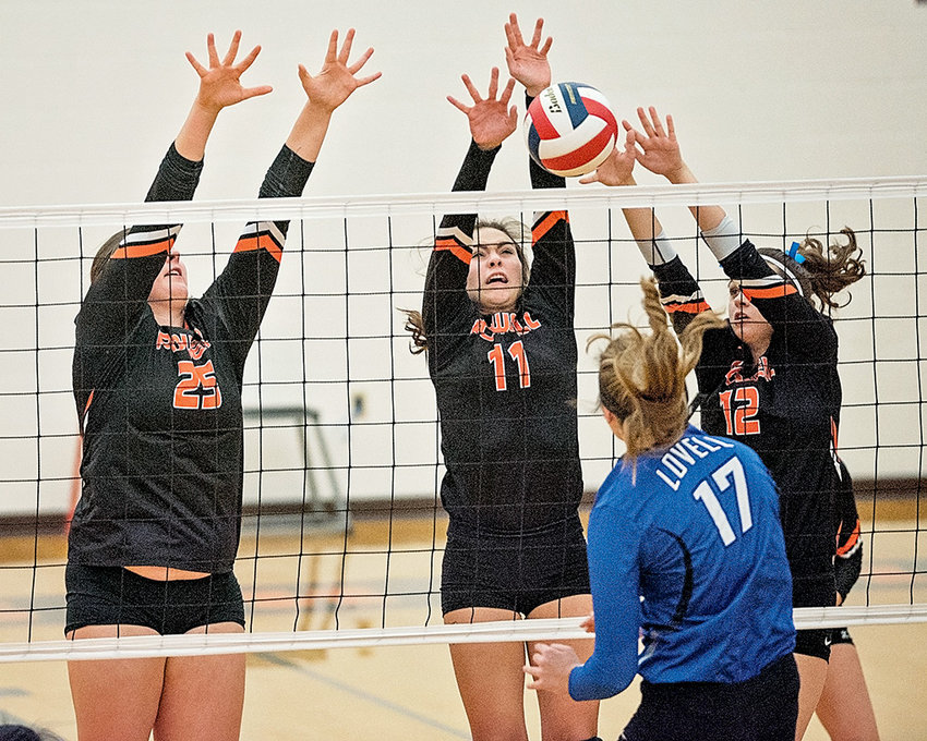 From left, PHS seniors Rachel Bonander, Jazlyn Haney and Hartly Thorington go up for a block against Lovell's Rhett Partridge Thursday at Powell High School. The Lady Panthers downed the Lady Bulldogs in straight sets, 3-0.