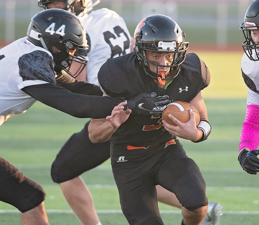 Powell quarterback Ethan Asher powers through the tackle of a Jackson defender en route to a 14-yard touchdown run Friday at Panther Stadium. The Panthers lost the final game of the season to the Broncs, 34-13.