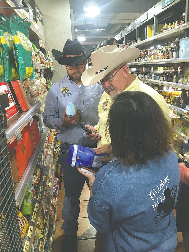 Forrest Smith (back) and his father Seaton Smith visit City Super, a higher-class supermarket in Taipei, Taiwan, earlier this month. The visit was part of a trade mission led by Wyoming Gov. Matt Mead.