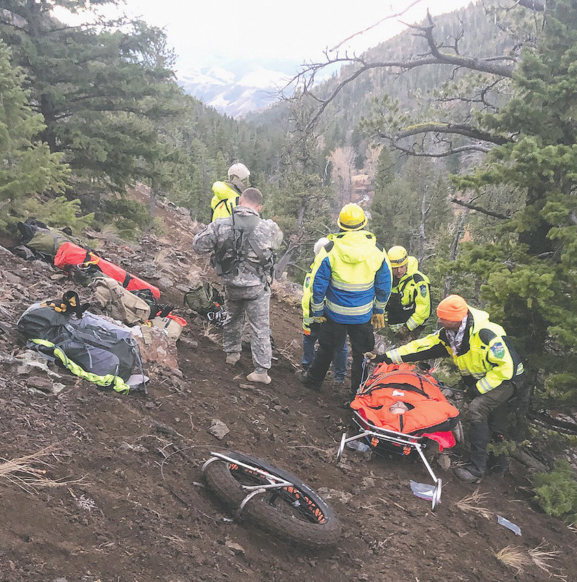 Personnel from Park County Search and Rescue and the Wyoming Army National Guard prepare to evacuate Scott Vaughn from some rugged backcountry on the North Fork Sunday morning.