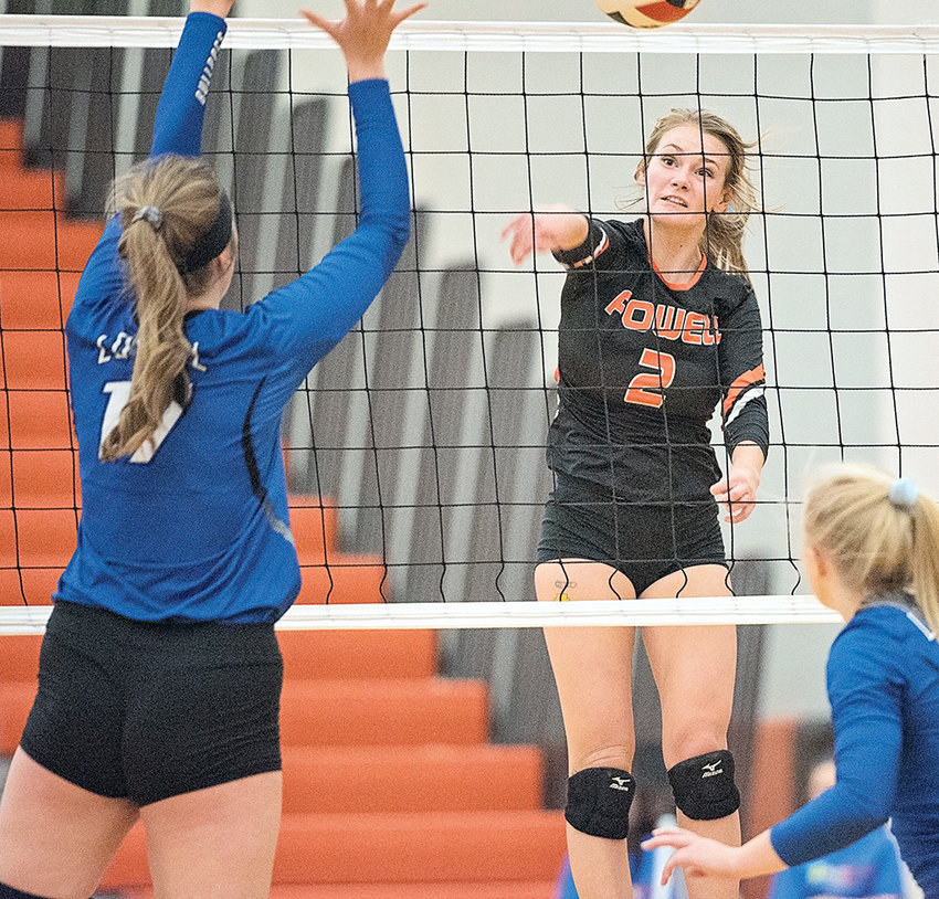 Powell senior Aubrie Stenerson hammers a shot past a Lovell player during a recent match at Powell High School. The Lady Panthers are headed to state following a third-place finish in last weekend's 3A West Regional Tournament in Mountain View.