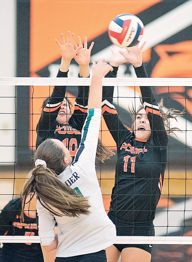 Powell's Sabrina Shoopman (left) and Jazlyn Haney go up for a block against Lander in a game earlier this season at Powell High School. The Lady Panthers head to Casper today (Thursday) for the opening round of the 3A State Volleyball Tournament.