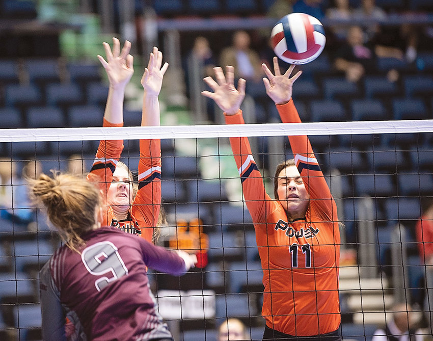 Powell's Devon Curtis, left, and Jazlyn Haney go up for a block against Torrington's Dani Masterson Friday at the 3A Volleyball State Tournament in Casper. The Lady Panthers finished 1-2 for the tournament, with losses against Douglas and Mountain View.