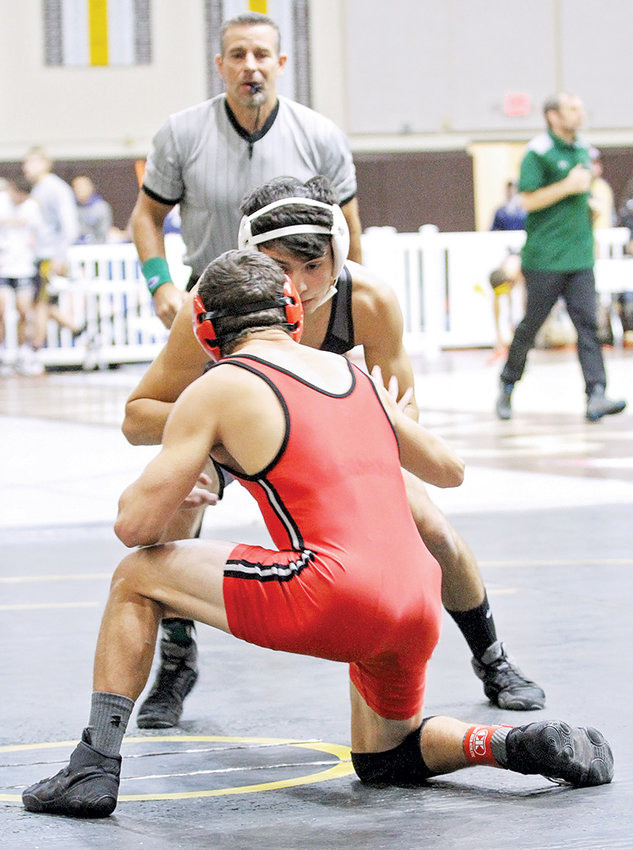 NWC wrestler William Fish squares off with an opponent at last weekend's Cowboy Open in Laramie. The Trappers won nine of 31 matches in the tournament.