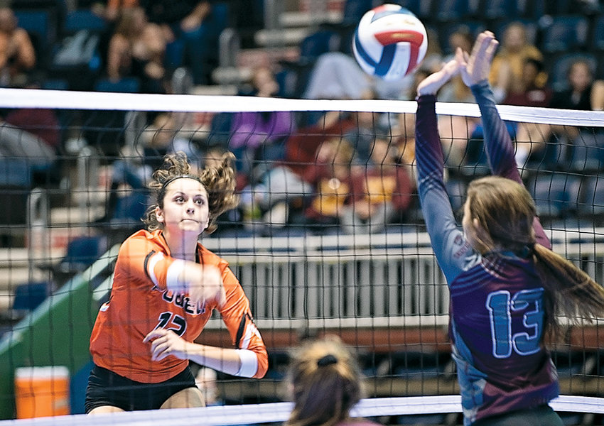 Lady Panther Hartly Thorington blasts a kill past Torrington's Avery West during the 2018 3A State Volleyball Tournament earlier this month. Thorington — along with teammates Aubrie Stenerson and Rachel Bonander — was named to the All-Conference team.