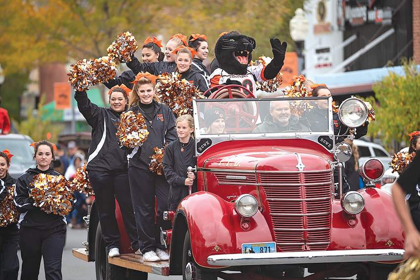 The PHS Panther cheer team rides down Bent Street during last month's Homecoming Parade. This year's squad is the largest in years, with 20 athletes participating.