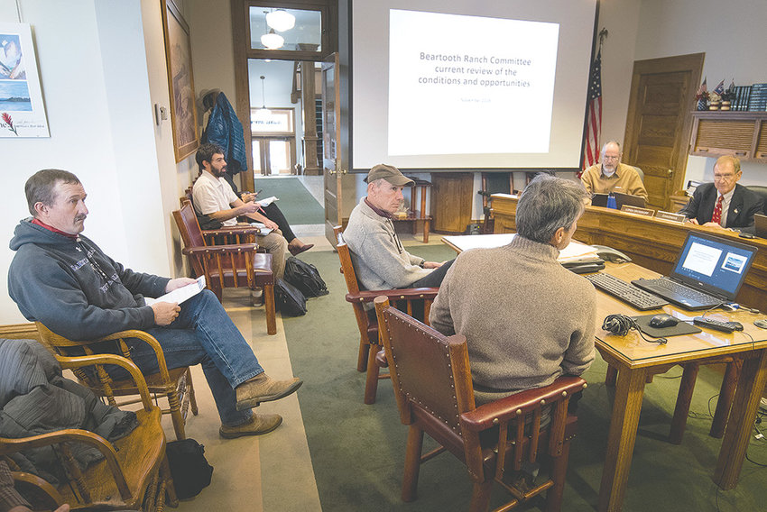Beartooth Ranch advisory committee leaders Len Fortunato (foreground) and Ken Lichtendahl (center) give a presentation to Park County commissioners on Nov. 7 while commissioner-elect and advisory committee member Lloyd Thiel (at left) watches from the front row of the gallery.