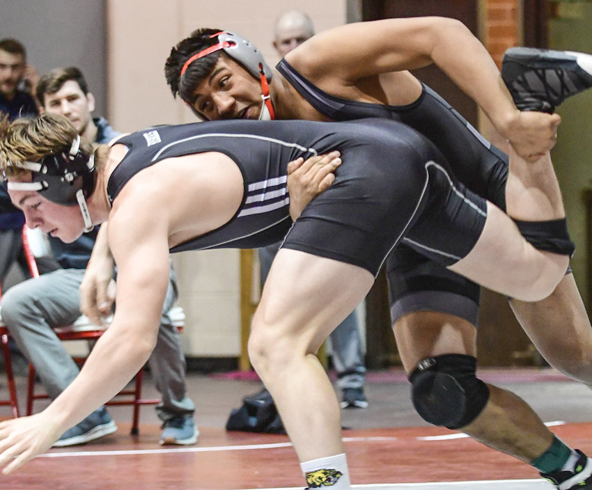 NWC freshman Yair Moran (top) defeats University of Providence's Alex Quick 4-3 in the 174-pound quarterfinal match at the NWC Open earlier this month. The Trappers head to Great Falls, Montana, this weekend for the Battle of the Rockies tournament.