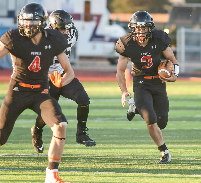 Panther quarterback Ethan Asher (No. 3) follows the block of teammate Dalton Woodward against Jackson during the final game of the season at Panther Stadium last month. Asher was named Most Valuable by his teammates at Tuesday's awards ceremony at Powell High School.