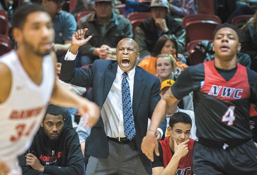 NWC head men's basketball coach Dawud Abdur-Rahkman expresses his displeasure during the first half of Saturday's game against Dawson Community College. The Trappers won the game 65-55.